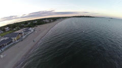 Aerials over beach at sunset Stock Footage