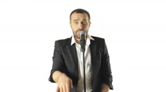 Handsome man performs a musical composition in the studio on a white background Stock Footage