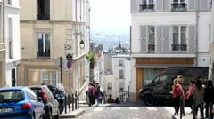 Tourists climb the slopes and streets of Montmartre in Paris Stock Footage