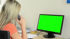 Young attractive woman working on computer in the office and phone -green screen Stock Footage
