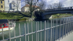 Tourist boat sailing on river Ljubljanica on a sunny day 4K Stock Footage