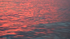 Sea wave reflection of sunset light - stock footage