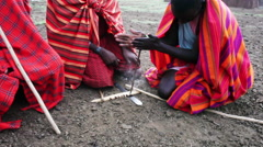 African tribesmen try and make fire Stock Footage