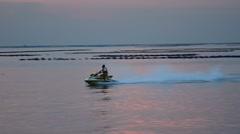 Jet Ski run on sea with sunset sky Stock Footage
