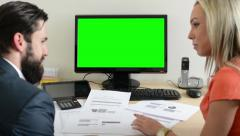Woman and man talk about document in the office - desktop computer green screen Stock Footage