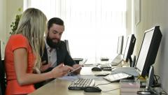 woman and man work on desktop computer and rejoice together in the office - stock footage