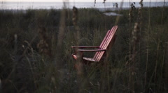 Chair in high grass Stock Footage