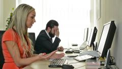 Woman and man work on desktop computer and are angry in the office (workers) Stock Footage
