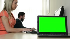 Computer (laptop) - green screen - man and woman work on the computer in office Stock Footage