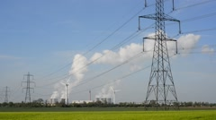 Power generating windmills and drax power station uk Stock Footage