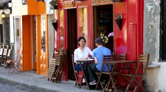 Young couple eating in the restaurant of Montmartre in Paris Stock Footage