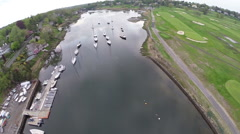 Boats in harbor, flyover aerial Stock Footage