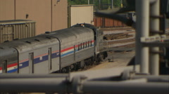 Train slowly moves thru Chicago railway yard (mute) Stock Footage