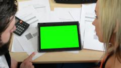 Man and woman work on the tablet in the office (papers) - green screen Stock Footage