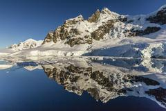 Reflections in the calm waters of the Lemaire Channel, Antarctica, Polar Regions - stock photo