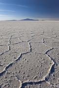 Volcano Tunupa on the horizon of the Salar de Uyuni, the biggest salt desert in Stock Photos