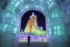 Spectacular illuminated ice sculptures at the Harbin Ice and Snow Festival in - stock photo