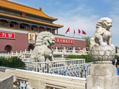 Tiananmen Sqaure in front of portrait of Mao Zedong on Gate of Heavenly Peace - stock photo