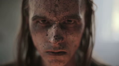 Portrait of a military man's face in blood and dirt - stock footage