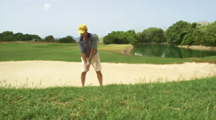 Slow motion golfer in sand trap Stock Footage