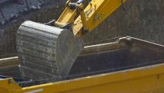Slow motion Dump truck being loaded with soil by shovel  Stock Footage