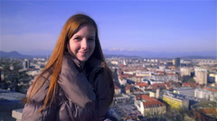 Confident woman looking in to camera above city scape 4K Stock Footage