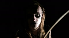 Drummer of black metal band. Close up face at dark background Stock Footage