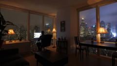 one person working at home in modern city apartment loft at night - stock footage