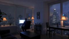 one man working home in modern high rise apartment loft at night - stock footage