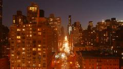 urban night lights background of city streets buildings. new york city skyline - stock footage