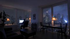 apartment loft with city view at night. person working at home. urban lifestyle - stock footage