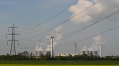 Time lapse power generating windmills and drax power station uk Stock Footage