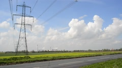 Traffic passing power generating windmills by Drax power station yorkshire uk Stock Footage