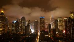 Stock Video Footage of clouds moving over skyline at night. urban city lights lifestyle background
