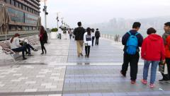 Following young couple walking on avenue of stars, Hong Kong Stock Footage