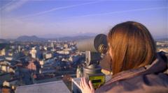Woman looking through Coin Operated Binoculars 4K Stock Footage