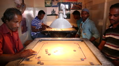 Indian man playing traditional Indian board game carrom one on one. Stock Footage