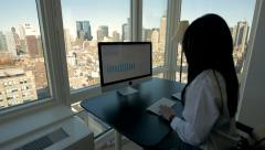 Business women working on computer desk in modern high rise office building Stock Footage