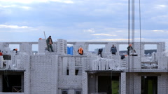 Construction of high-rise houses of brick in a cloudy day Stock Footage