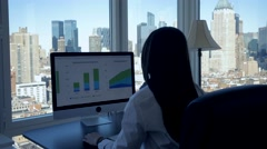 Women working home. computer desk. modern office interior with city window view Stock Footage