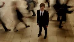 people moving around one man standing out of the crowd. motion blur - stock footage