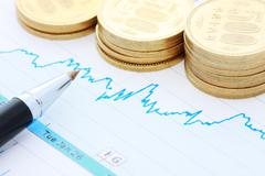 Stock Share Market Plot with Japanese coins Stock Photos