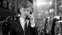 Young man talking in phone booth getting bad news. frustrated sad person Stock Footage