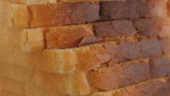 Toast bread pieces arranged on table 4K 2160p UltraHD tilting footage - Toast Stock Footage