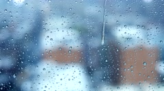 Stock Video Footage of rainy day in the city. rain drops on window glass. depressive mood background