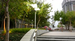 Urban ultra modern park in evening time, stone and trees Arkistovideo