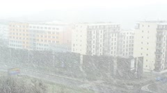 Snowstorm in the city - road - building (flats) Stock Footage