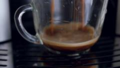 Coffe dispenser with cup of coffee. Slowmotion pouring Stock Footage