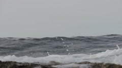 Waves rolling to the shore of Paphos, loopable - stock footage