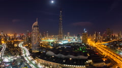 Dubai, Night to day Time lapse over the Burj and City Skyline Stock Footage